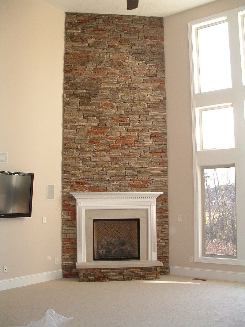 Floor to ceiling two story stone fireplace